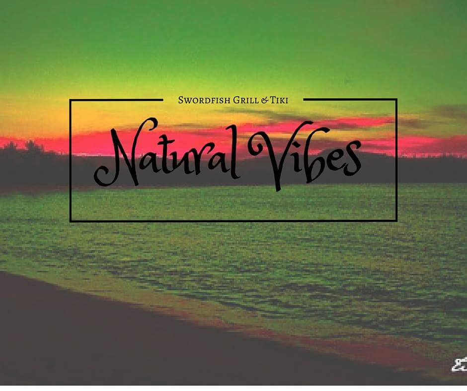 Natural Vibes words with a beach background
