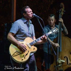Doug Deming standing playing guitar next to man on stand up bass.